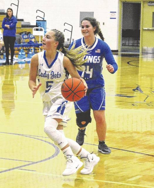 Belle Cable drives to the basket during a Cross County Conference battle with Miami East on Thursday. The Lady Jets won the game, 41-33.