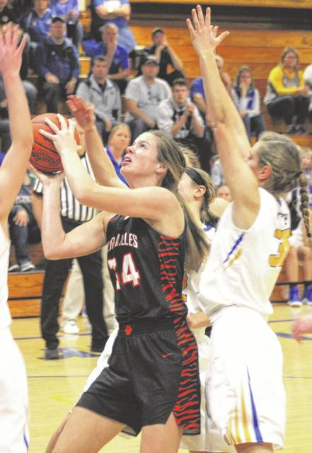 Versailles junior Brooke Stonebraker (34) goes up strong early in a Midwest Athletic Conference game at Marion Local on Thursday night. Stonebraker finished with 12 points and the Tigers rallied to beat the Flyers 56-47 in overtime.