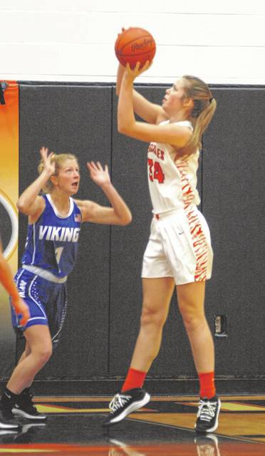 Brooke Stonebraker takes a shot from underneath the basket during Versailles' home game with Miami East on Saturday. The Lady Tigers won the game, 38-34.