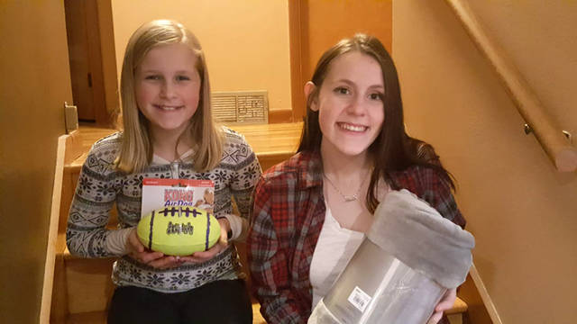 Sisters Bridget Unger (left) and Rachel Unger (right) are collecting items for their charity, Comforting Comforters. Items can be dropped off at Tangles salon, the Greenville Public Library, DeColores Montessori School and Montage Cafe in Greenville.