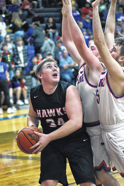 Mississinawa Valley's D.J. Howell scored a game-high 21 points in leading the Blackhawks to a Cross County Conference win over Tri-Village on Friday night. MV won the game, 58-42.