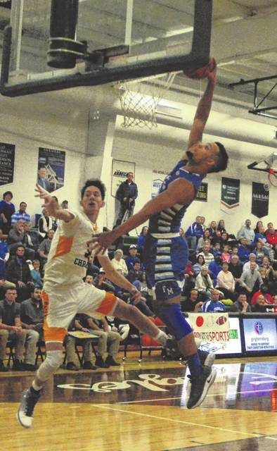 Franklin-Monroe senior Ethan Conley goes for a dunk against host Troy Christian on Friday night. Conley finished with 21 points, but the Jets lost the game 44-42.
