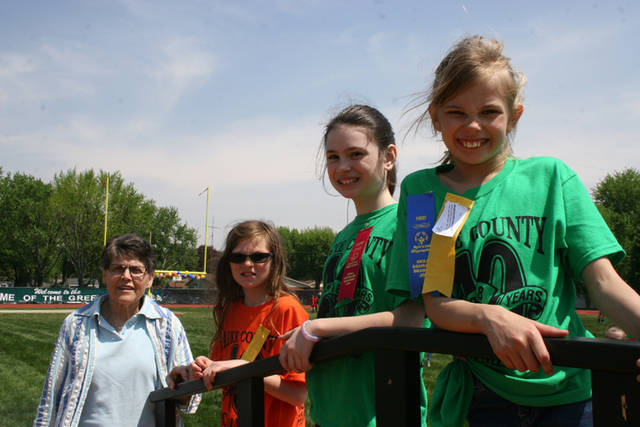 Pictured at the May track and field event is Mary Jane Dietrich representing the Auxiliary. She served as an awards presenter for various events including the standing long jump event for girls, in the 8-11 year division. Shown (l-r) are Caitlyn Hemmelgarn of Bradford Elementary, Macey Berry of Greenville Elementary and Abby Schauer of Greenville Elementary.