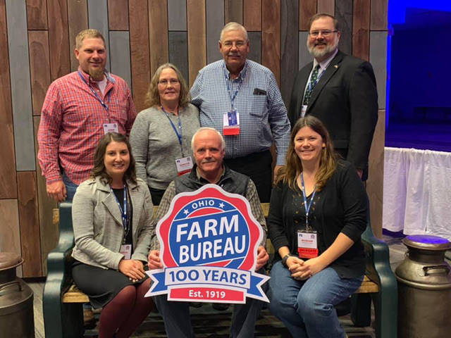 Farm Bureau's business sessions included 356 delegates representing all 88 counties. Pictured are (sitting, l-r) Darke County Farm Bureau Organization Director Melinda Lee, Jim Rismiller, Morgan Aultman, (standing, l-r) Korey Harrod, Marilyn Morrison, Paul Morrison and Matt Aultman.