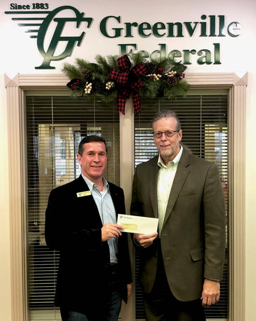 Clay Johnson, Garst Museum CEO (right), is shown with Jeff D. Kniese, president and CEO of Greenville Federal (left).