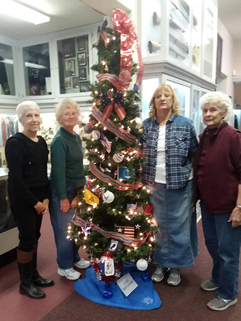 Fort GreeneVille Daughters of the American Revolution decorated a Christmas tree in the military room at the Garst Museum for the annual Holiday Open House. Members decorating were Corrinne Zwiesler, Caroline Petitjean, Sandra King and Helen Wright.