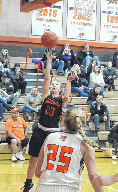 Arcanum senior Gracie Garno (23) scores what proved to be the winning layup here as the Lady Trojans took the lead with a minute to play and held on for a 50-44 win over National Trail on Thursday.