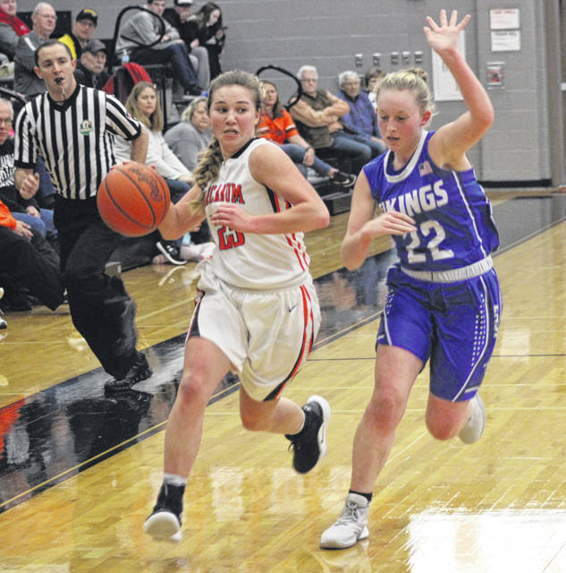 Arcanum's Gracie Garno brings the ball up the floor with a Miami East defender right alongside during the first half their game on Saturday. The Vikings won the game, 54-41.