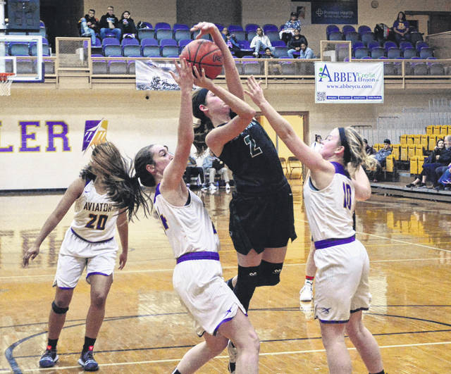 Greenville junior Haleigh Mayo tries to shoot with a pair of Butler defenders surrounding her on Wednesday night in a Greater Western Ohio Conference North Division game. The Aviators defeated the Lady Wave, 38-19.