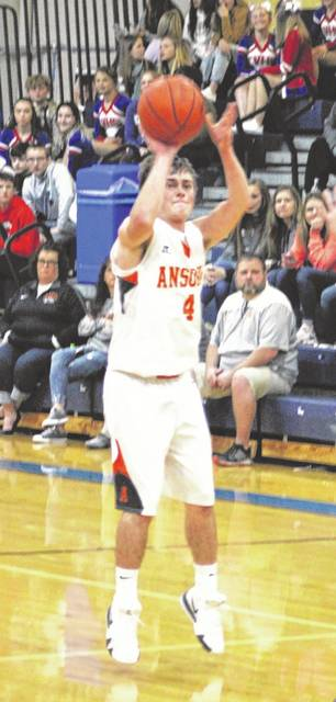 Ansonia junior Hunter Buckingham shoots a 3-pointer during the second half of the Tigers game with Eaton on Friday night in the Patriot Holiday Classic tournament at Tri-Village. Ansonia won the game 54-41.