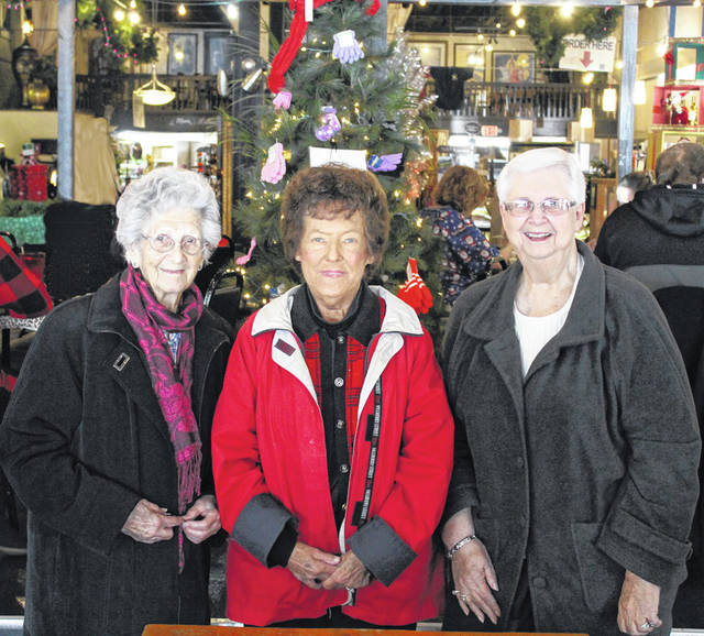 Darke County Senior Citizens Virginia O'Dell, Charlene Bergman and Shirley Jones were at Montage in downtown Greenville Tuesday to donate to the FISH Mitten Tree. Donated gloves and mittens will be distributed to children enrolled in the Darke County Head Start programs.