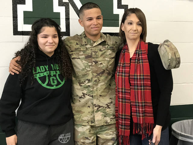 Private Second Class Derrick Smith, a 2018 Greenville High School graduate, came home for a surprise reunion with his sister, Greenville junior Chloe Mitchell, in the school's cafeteria.