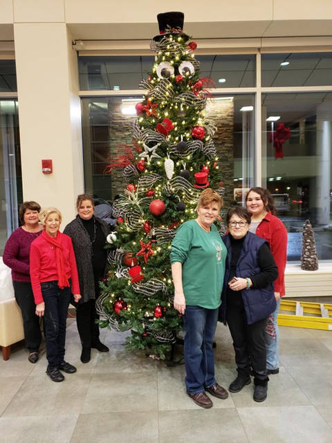 "Guests will be greeted by ""Hats off to the Holidays"" when they visit Wayne HealthCare, 835 Sweitzer St. in Greenville. Members of the Ladybug Garden Club decorated the front lobby with special snowmen Christmas trees. Decorating were (l-r) Carol Hosbrook-Cole, Shirley Linder, Amy Addis, Angela Beumer, Barbra Skinner and Mariana Ramos. Not shown is Irma Heiser."