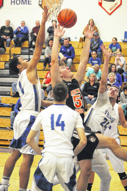 Arcanum's Lane Byrne (50) is surrounded by Miami East defenders as he tries to score during first half action on Tuesday night. The Vikings won the game, 41-26.