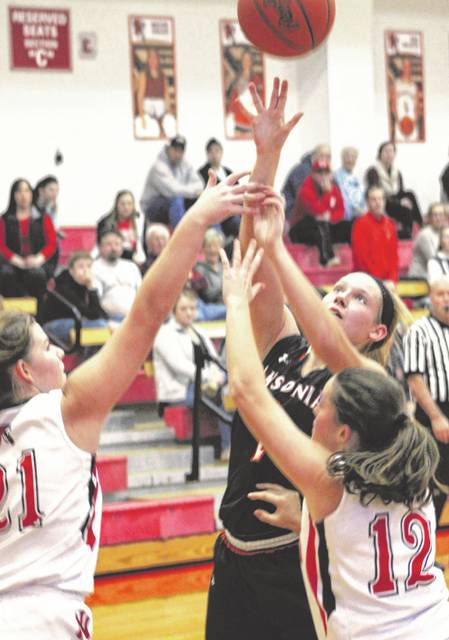 Ansonia's Mariah Troutwine (2) puts up a shot surrounded by several Newton defenders during second half action of their game on Thursday night. The Indians won the game, 61-41.
