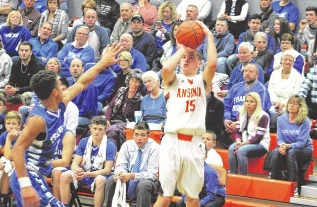 Matthew Shook (15) led Ansonia with 20 points as the Tigers rallied from a 13-point deficit to defeat visiting Franklin-Monroe 77-67 on Friday night.