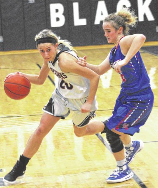 Mississinawa Valley's Olivia Murphy drives around a Union City defender during the first half of their game on Saturday. Union City won the matchup, 59-26.