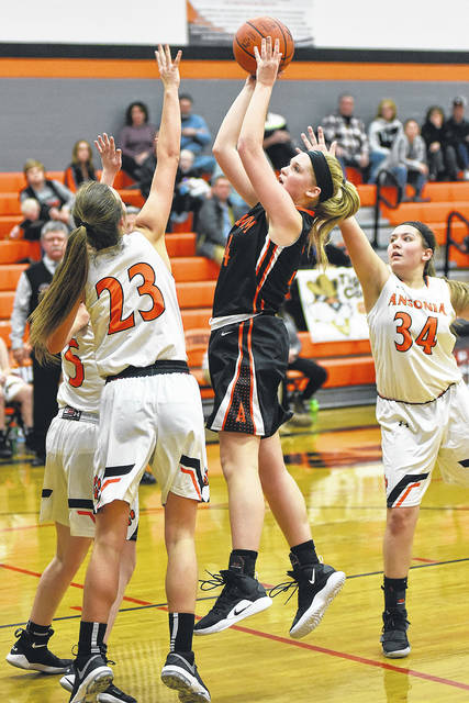 Arcanum freshman Taylor Gray scored a game-high 20 points to lead the Trojans to a 66-34 win over Ansonia on Thursday.