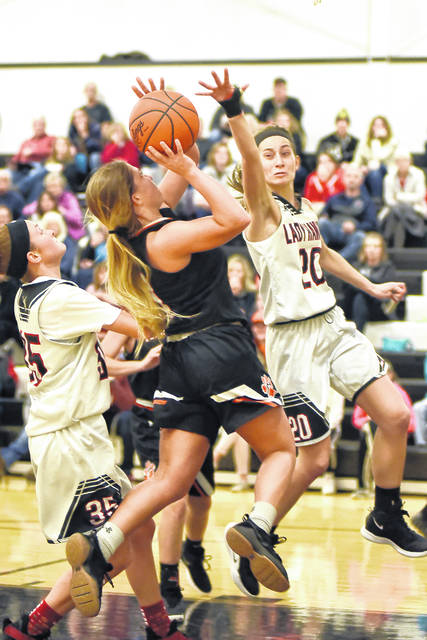 Ansonia senior Trinity Henderson goes in for a layup during the Tigers rivalry game at Mississinawa Valley on Saturday. Henderson finished with a team-high 17 points in a 74-49 win over the Lady 'Hawks.