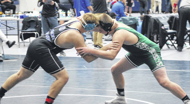 Greenville wrestler Tytan Grote (right) has 11 wins and 9 pins so far this season at 220 pounds.