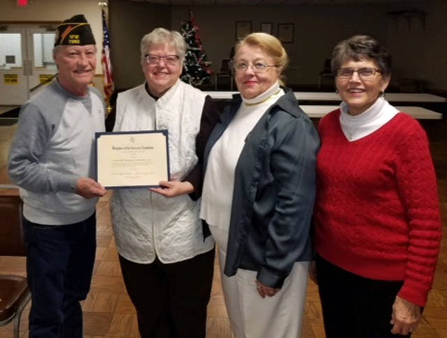 Fort GreeneVille chapter DAR recently awarded a certificate to the Greenville VFW Post 7262. The certificate was awarded for the VFW's continuous support to the various veteran/military related projects that Fort GreeneVille DAR has done in the past and currently. Pictured are Post 7262 Commander Ron Mills, Vice Regent Brenda Arnett, Karen Burkett and Mary Jane Dietrich.