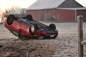 Driver escapes injury in rollover accident
