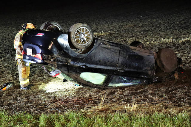 A black Hyundai Elantra was traveling eastbound on U.S. Route 36 when the driver lost control of the vehicle after encountering standing water on the roadway, causing it to hydroplane off the left side of the road.
