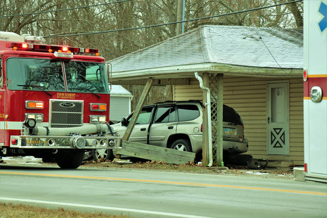A driver narrowly escaped injuries after crashing into multiple parked vehicles, a utility pole and the front carport of a house on State Route 571.