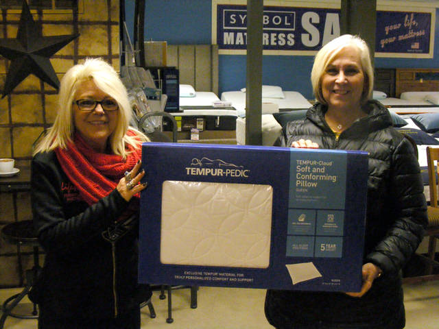 Peggy Bush (left) presents an orthopedic pillow from LifeStyle Furniture to Deb Metzger of Arcanum, a winner in The Daily Advocate's 12 Days of Giving. To enter, visit https://www.dailyadvocate.com/12-days-of-giving.