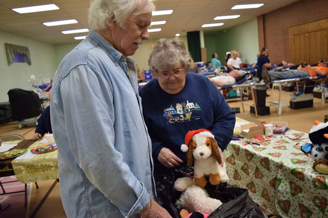 Greenville Lions Club volunteers Dick Helman & Nancy McClurg gather stuffed animals for young patients at Wayne HealthCare.