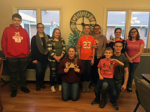 Versailles FFA members are shown with the craft created by the residents of the nursing home. Pictured are (back row, l-r) Zach Watren, Emily Delzeith, Paige Gasson, Lexie Demange, Laura Wuebker, Abby Petitjean,Ashleigh Shimp, (front row, l-r) Breanna Nieport and Franklin Shimp.