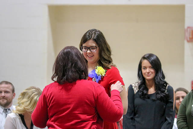 Carly Brown, of Piqua, receives her pin from Peggy Montgomery, Edison State assistant professor of nursing.