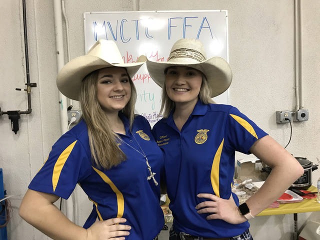 The MVCTC FFA raised more than $8,500 during the 38th annual Charity Auction for the Ronald McDonald House Charities of Dayton. Pictured (l-r) are MVCTC FFA Chapter Officers working at the event, Myckala Geisler (Miamisburg) and Anna Grant (Valley View).