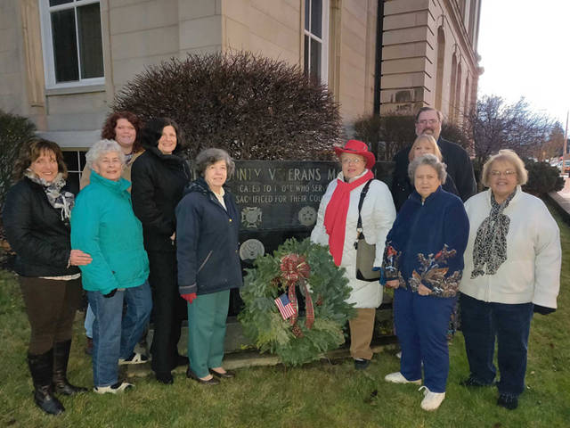 Fort GreeneVille chapter had a Christmas wreath dedication at the Darke County Veterans Memorial marker at the Darke County Courthouse. The wreath is in honor of all Darke County veterans and active duty military. The wreath was purchased from the Ladybug Garden Club. Pictured are Debbie Nisonger, Helen Wright, Chris Nehring, Carla Surber, Linda Riley, Karen Burkett, Doris Aultman, Sandra King, Darke County Commissioner Matt Aultman and Ladybug Garden Club member Charlene Thornhill.