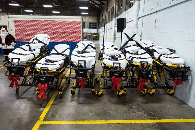 All wrapped in bows, six Stryker power cots sit at the Spirit North Pole, one of many shocking surprises during the company's recent Christmas celebration.