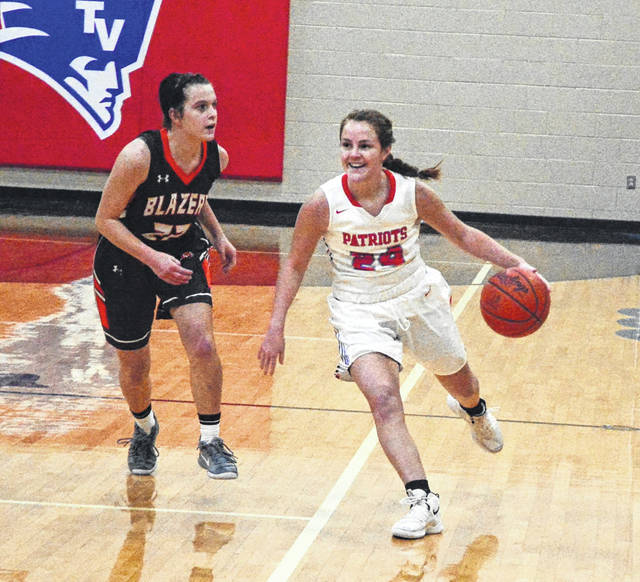 Tri-Village point guard Andi Bietry brings the ball up court during a game with Cross County Conference foe National Trail on Thursday. The Patriots won the game, 54-13.