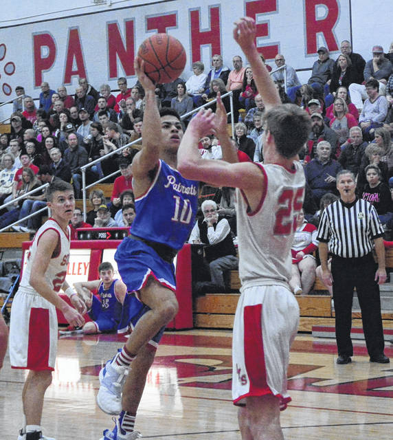 Tri-Village's Austin Bruner goes in for a score against Twin Valley South on Friday night. The Panthers won the game, 73-35.