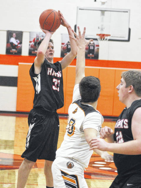Mississinawa Valley's Blake Scholl shoots a 3-pointer against Bradford on Friday night. Scholl hit four triples in the game and totaled 21 points in leading the Blackhawks to a 62-21 win over the Railroaders.