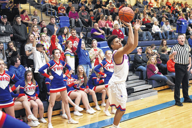 Tri-Village senior Austin Bruner shoots a 3-pointer from the corner in the Patriots 67-38 win over Houston on Saturday.