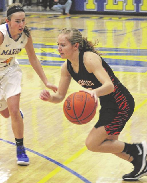 Junior Caitlin McEldowney is one of Versailles' leading scorers this season and is also near the top in assists among players in Darke County.