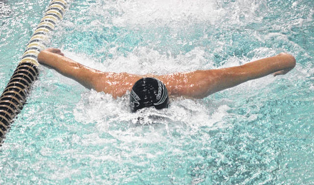 Greenville's Carlos Badell swims the butterfly stroke as part of the 200-yard medley relay team during the Versailles Quad swim meet last week. Badell is among the Darke County leaders several events.