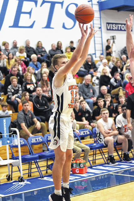 Arcanum junior Carter Gray shoots one from the corner against Mississinawa Valley on Saturday in the consolation game of the Jet Holiday Tournament. The Trojans won the game, 53-46.