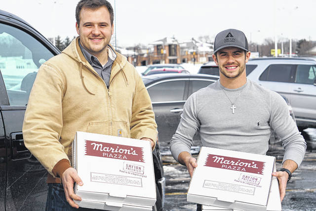Arcon Builders of Arcanum delivered 30 pizzas Tuesday to unpaid federal workers at Dayton International Airport. Pictured are Ray Mervar (left) and Alec Shellabarger (right).