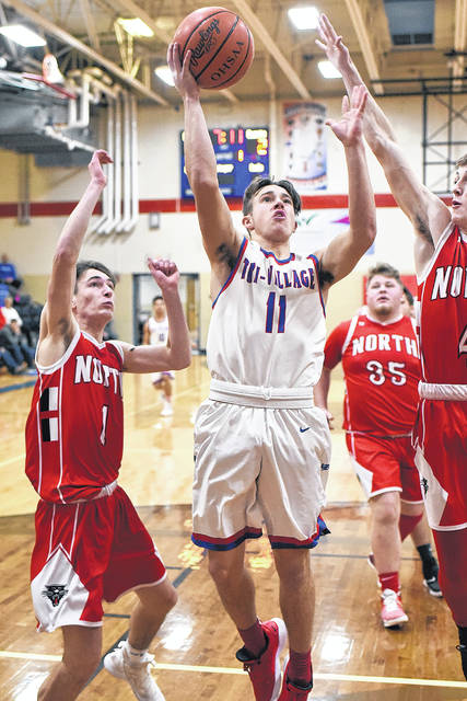 Tri-Village's Derek Eyer cuts to the rim through the Tri-County North defense during their Cross County Conference game on Friday night. The Panthers won the game, 73-66.
