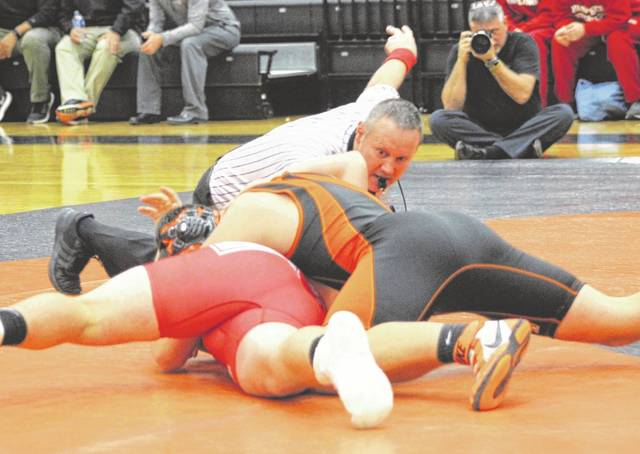 Arcanum's Dylan Rhodehamel earned a pin win in 1:58 over Kyle Donohoo of Tri-County North in a dual match with the Panthers on Monday. TCN won the match, 40-24.