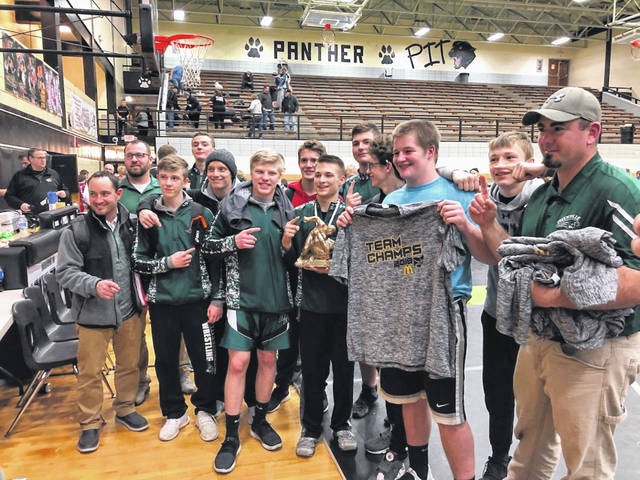 The Greenville wrestling team celebrated its team championship at the Miami Trace McDonald's Invitational on Saturday. The Wave scored 280.5 points to win the 18-team tournament and had two individual weight class champions with Drayk Kallenberger at 113 pounds and Jacob Mikesell at 152 pounds.