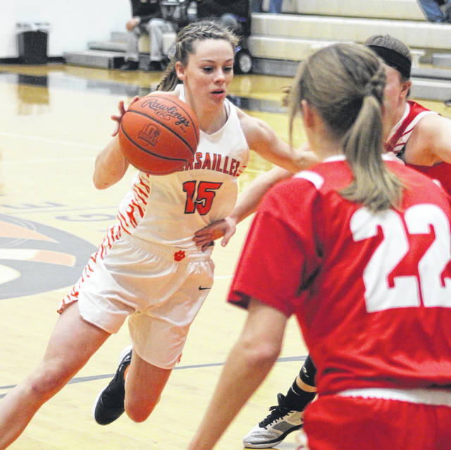 Versailles junior Hannah Barga drives to the basket during a Midwest Athletic Conference battle with St. Henry on Thursday night. Barga led the Lady Tigers with 10 points in their 49-43 win over the Redskins.
