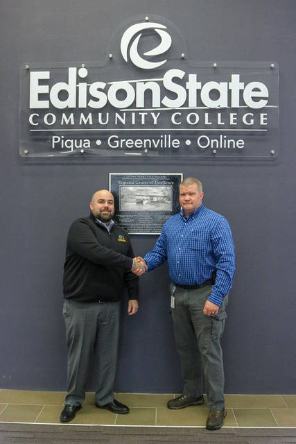 Charlie Carpenter (left), director of skill education at Hobart Institute of Welding Technology, and Tony Human (right), dean of professional and technical programs at Edison State, meet on behalf of the two institutions entering a consortium agreement.