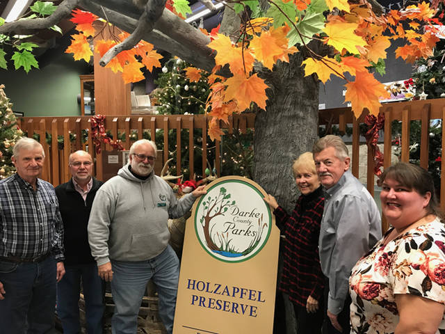 Pictured (l-r) are park board members Roger Brocious, John Cook, Director Roger Van Frank, Elaine Holzapfel, Bob Nelson and park board member Tina White during the acceptance and sign unveiling during the Darke County Parks Board of Trustees meeting in December 2018.
