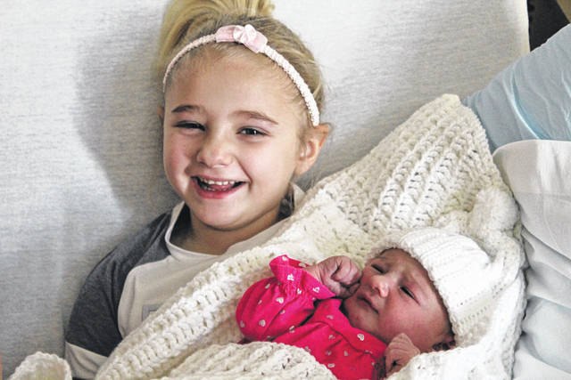 Hayden Phillips, 5, of Greenville, holds baby sister Rilee Jo, born Jan. 2 at Wayne HealthCare. Rilee Jo is Darke County's first baby of 2019.